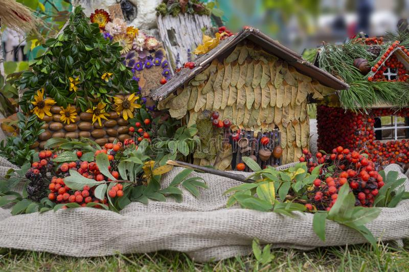 Colorful display of autumn toy cottages in a field stock images