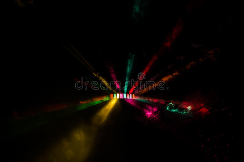 Colorful DJ Light show. A colorful and dark dj light show with smoke stock photos