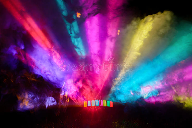 Colorful DJ Party Lights and Fog Shining From Floor. Upward and spread out to far corners royalty free stock photo
