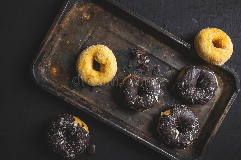.Colorful donuts on Black table. Top view royalty free stock photography