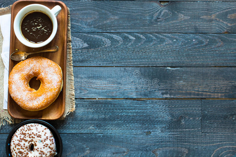 Colorful Donuts breakfast composition with different color styles stock images