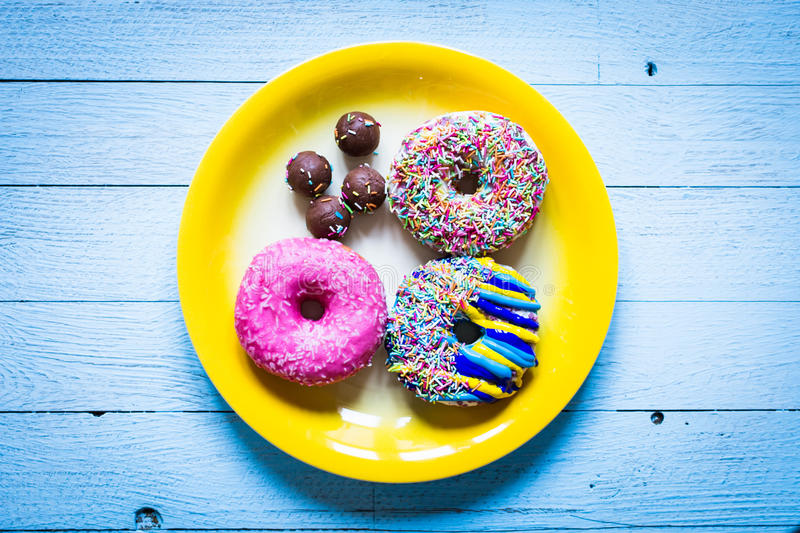 Colorful Donuts breakfast composition with different color styles royalty free stock photography