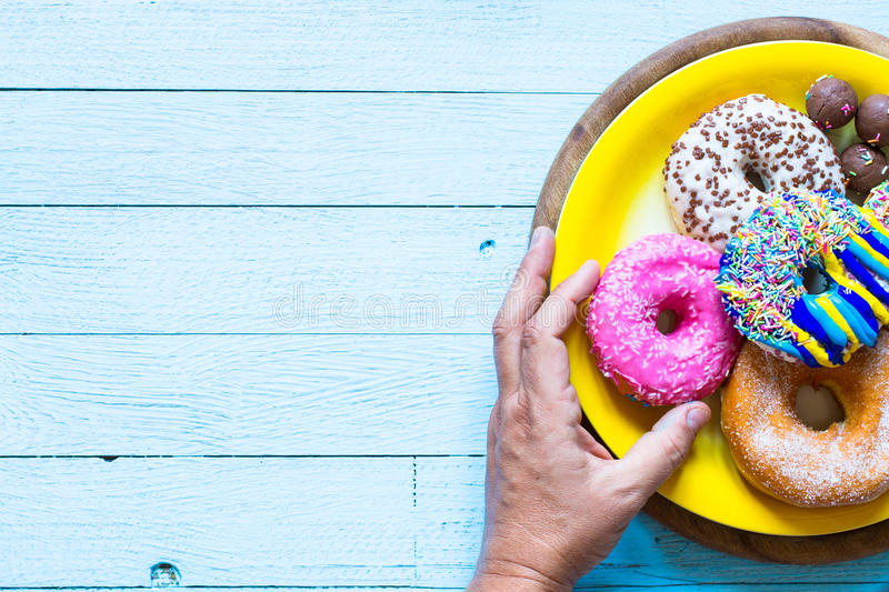 Colorful Donuts breakfast composition with different color styles stock photography
