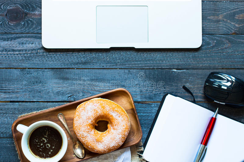 Colorful Donuts breakfast composition with laptop and coffee mug stock image