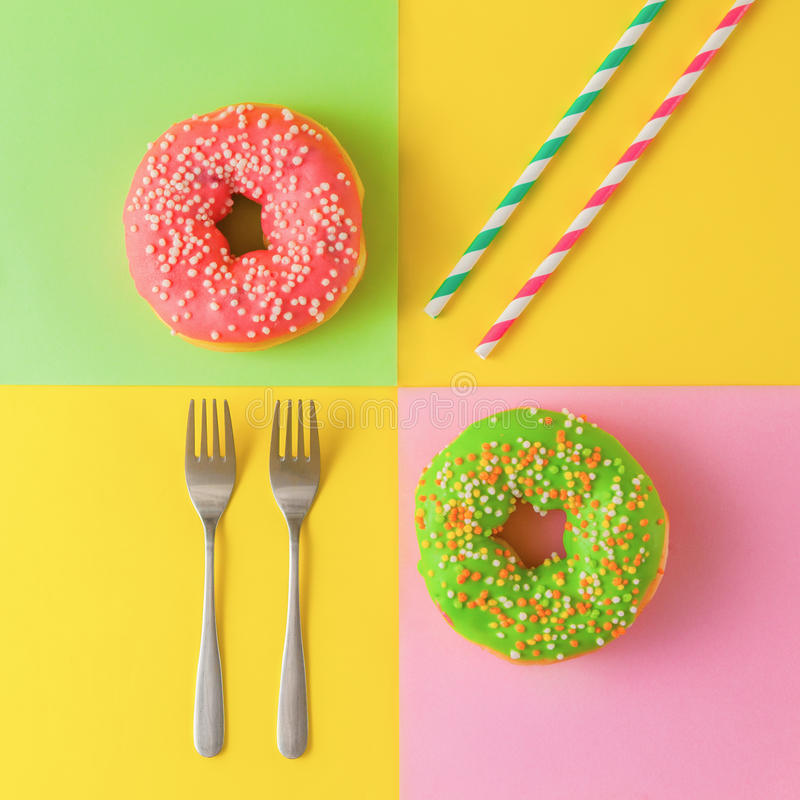 Colorful donuts on a yellow background stock image