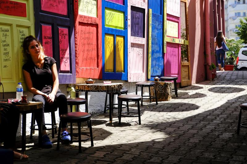 Colorful doors on a street coffee in Turikey. Colorful doors on a street coffee with some tables and stools royalty free stock images