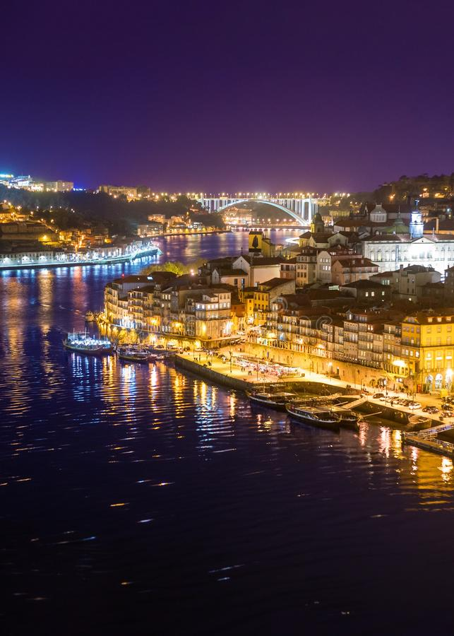 Colorful downtown river city with bridges at night background, Porto stock image