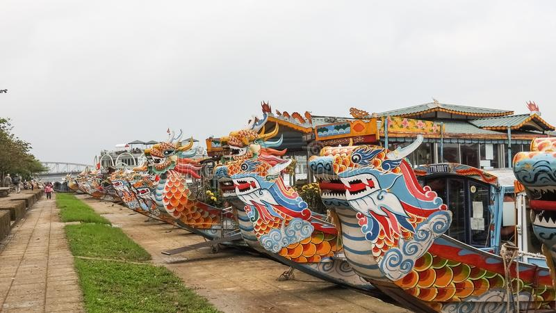Dragon boats at the Perfume river in Hue Vietnam. Colorful dragon boats at Perfume river in Hue Vietnam stock photo