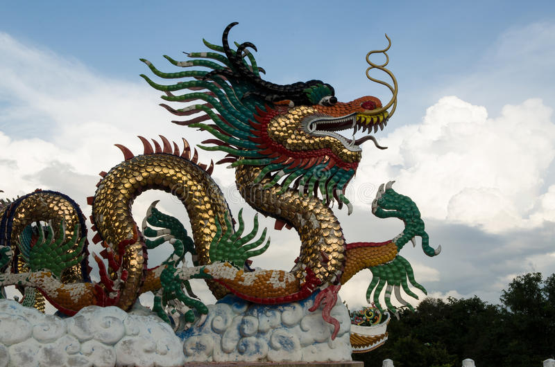 Colorful Dragons. Dragons in the park with sky stock photo