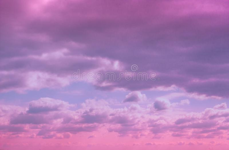 Colorful dramatic lilac sky and ultra violet clouds. Nature background with space for copy royalty free stock image