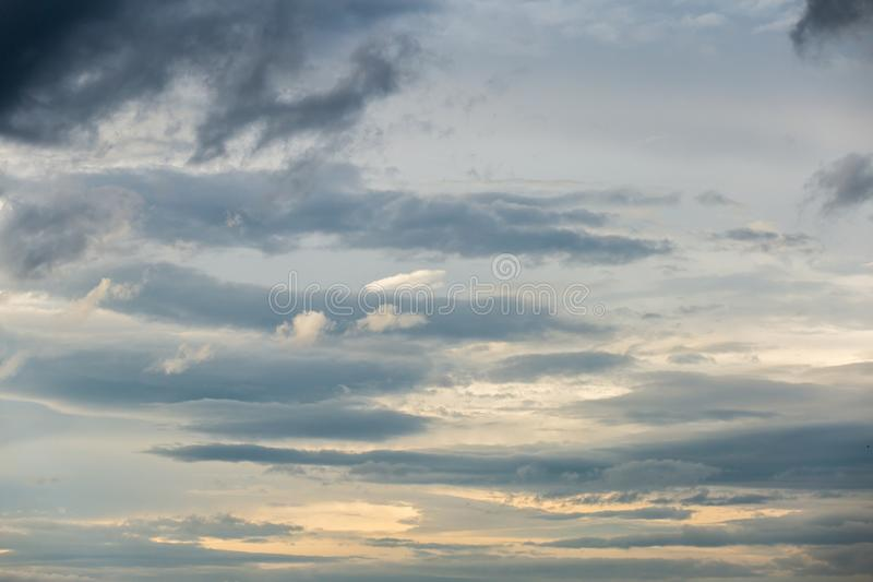 Colorful dramatic sky with cloud at sunset. Backgrounds blue bright cloudscape dark dawn dusk ethereal golden heaven landscape moody morning multi nature night royalty free stock photo