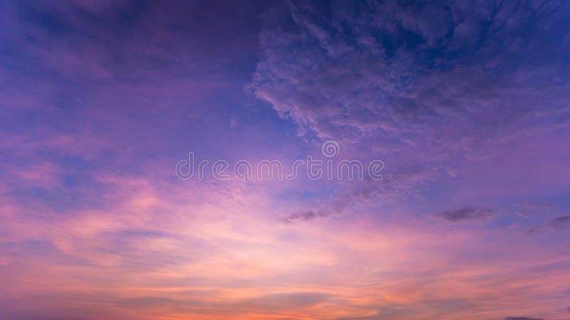 Colorful dramatic sky with cloud at sunset.Sky with sun background. stock photo
