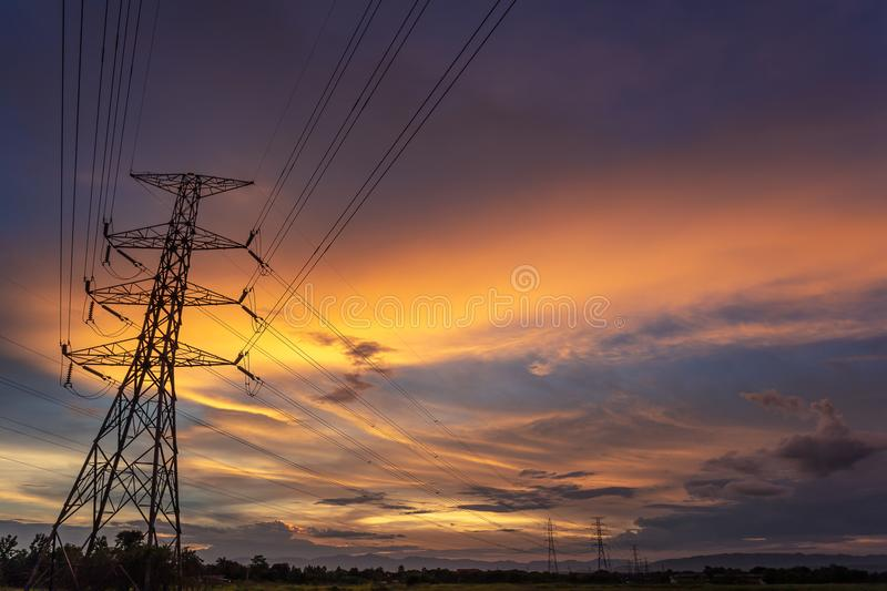 Colorful dramatic sky with Silhouette of high voltage pole and s royalty free stock images