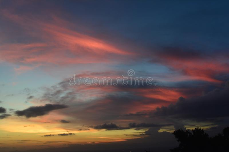 Colorful dramatic sky with sunset and claud. Dramatic color of the sky with sunset and black orange yellow clouds over the Indonesian sky in the dry season after stock photos