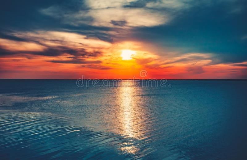 Colorful and Dramatic Sunset Sky Ocean Background stock image