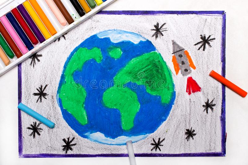 Drawing: Rocket in space, flying next to the planet earth royalty free stock photos