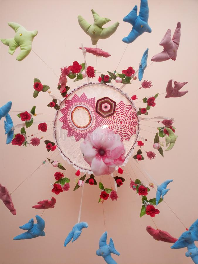 Colorful dream catcher. View of a beautiful colorful dream catcher on a ceiling stock photo