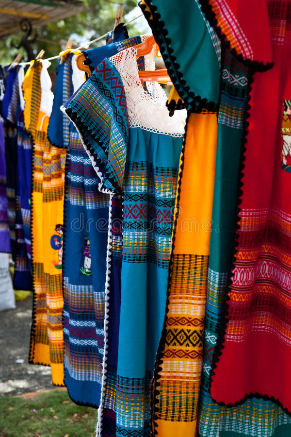 Colorful dresses on a cloth line. Colorful dresses made in Caribbean royalty free stock photo