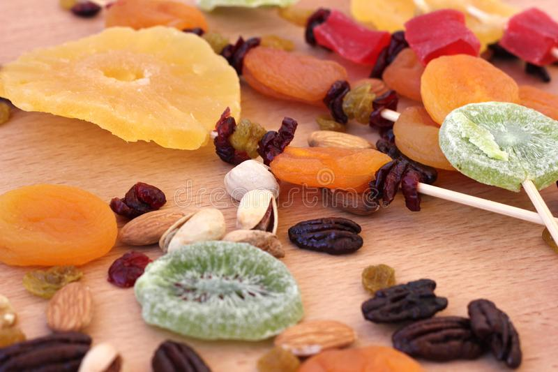 Colorful dried fruits for the Jewish holiday of Tu Bishvat. Various dry fruits on a wooden table background for the Jewish holiday of Tu BiShvat royalty free stock image