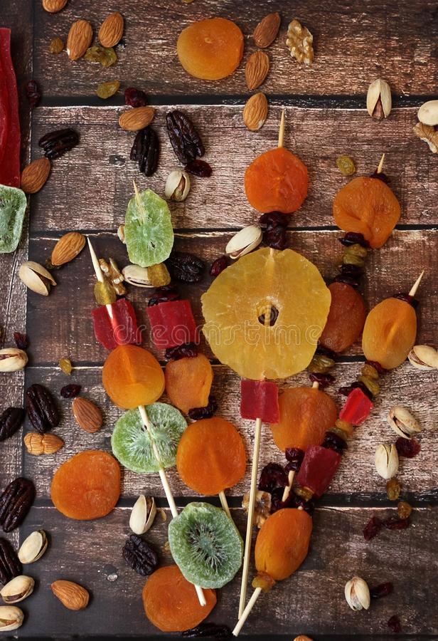 Colorful dried fruits for the Jewish holiday of Tu Bishvat. Various dry fruits on a wooden table background for the Jewish holiday of Tu BiShvat stock images