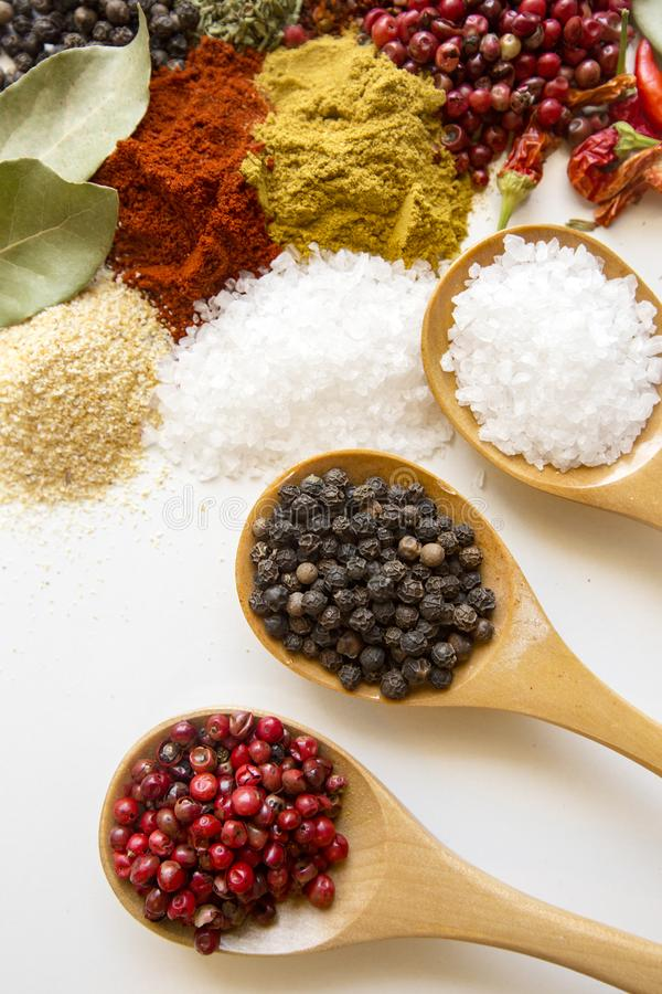 Colorful dry herbs and spices for cooking food white kitchen table background top view space for text stock photography