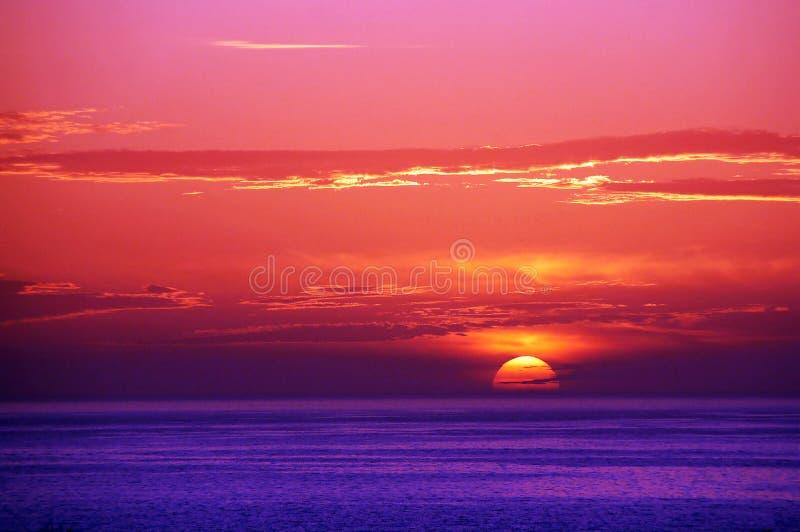 Colorful dusk. Pink, red, orange, blue, purple, dusk very colorful in Canary Islands, Santa Cruz de Tenerife Spain stock photo
