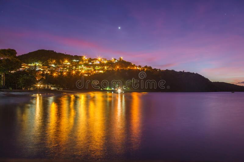 Colorful dusk sky over Anse a l'Ane beach and calm bay with peaceful Caribbean sea, Martinique island, Lesser Antilles royalty free stock image