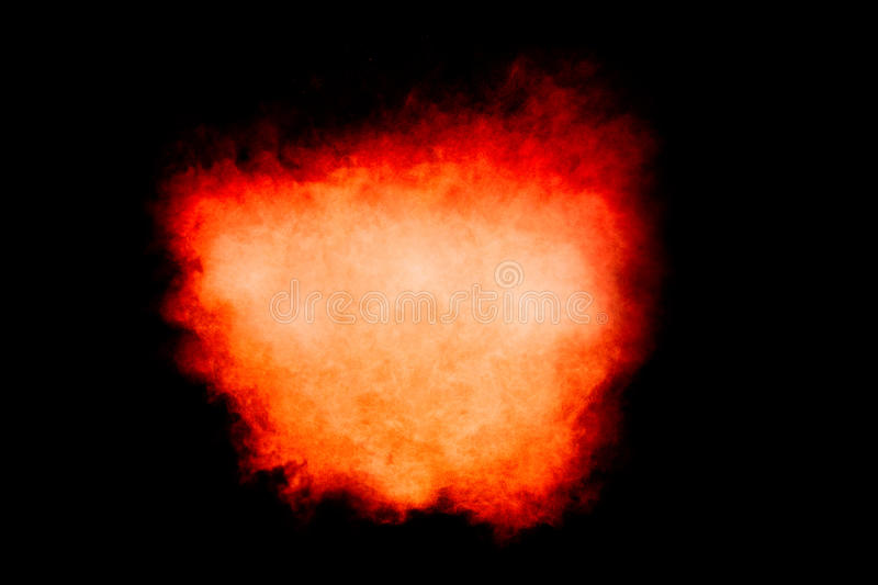 Colorful Dust Particle Explosion Isolated on Black. Colorful dust particle explosion resembling a fire explosion over black. Closeup isolated on black with copy stock images