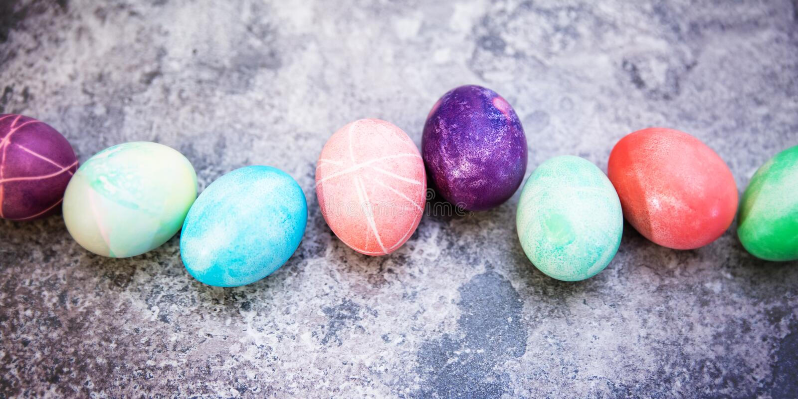 Colorful dyed easter eggs in a line, topview, greeting easter ca royalty free stock images