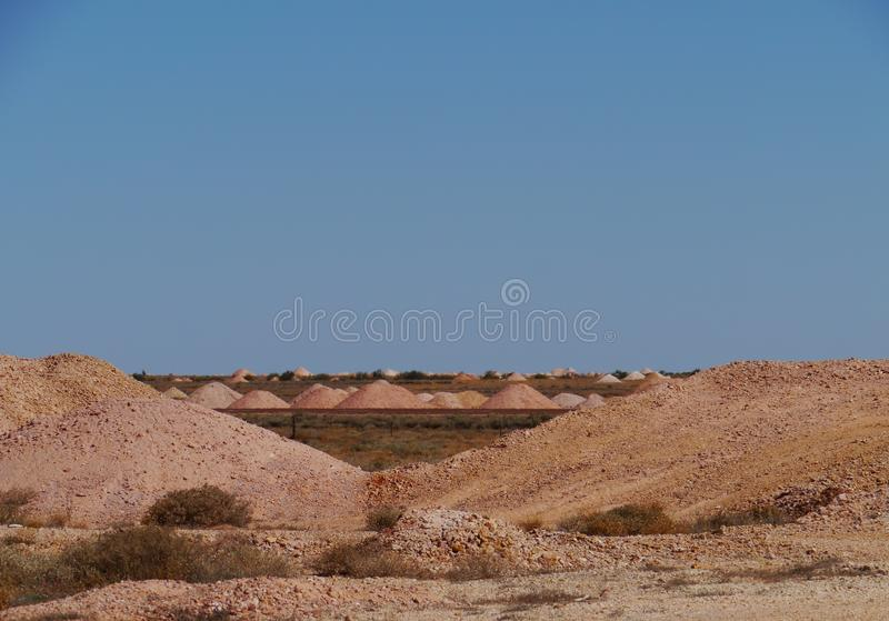 Colorful earth hills. Coober Pedy is a town in northern South Australia at the Stuart Highway and is famous for its opal mines royalty free stock photography