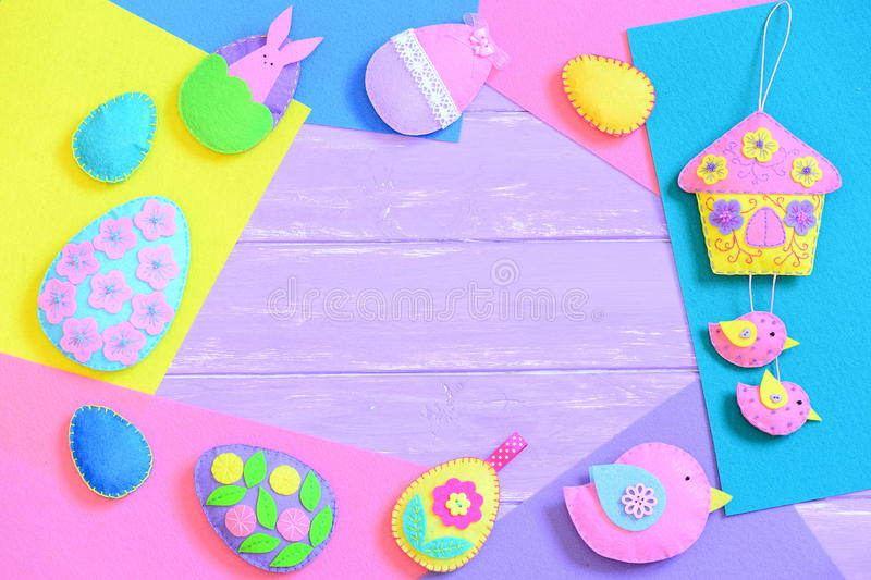 Colorful Easter background. Creative felt Easter crafts on felt sheets and on lilac wooden background with copy space for text stock photography