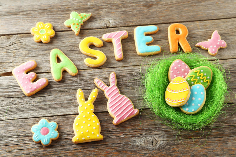 Colorful easter cookies. On grey wooden background royalty free stock image