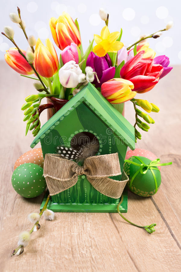 Colorful Easter decorations with eggs and tulips royalty free stock photo
