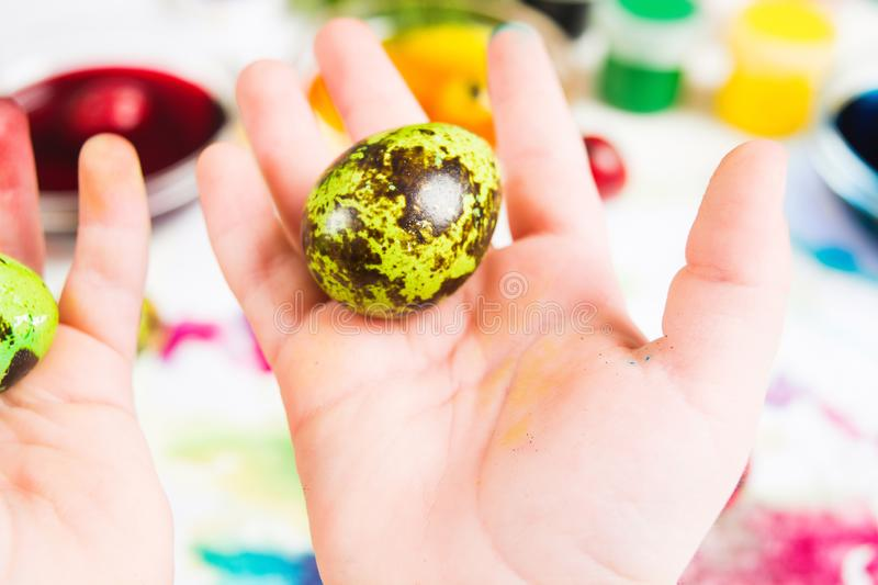 Colorful easter egg in child`s hand royalty free stock photos