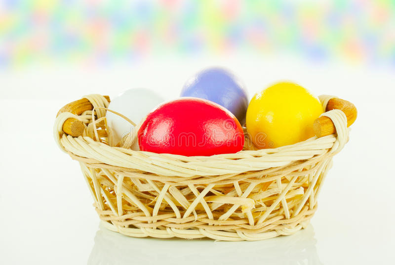 Download Colorful Easter Eggs In A Basket Stock Photo - Image: 23012050
