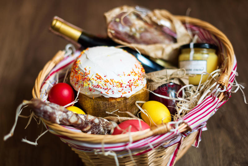 Colorful easter eggs in a basket with cake red wine hamon or download colorful easter eggs in a basket with cake red wine hamon or jerky negle Image collections