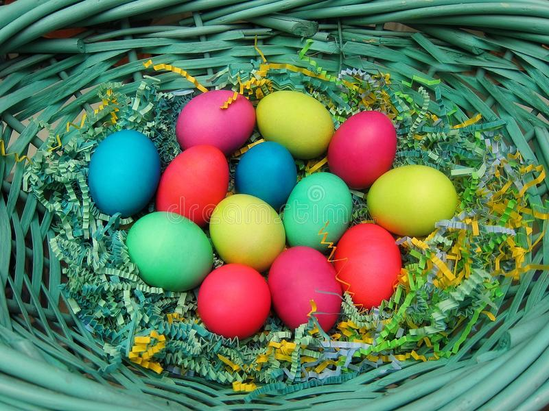 Colorful Easter eggs in a basket Christian holiday celebration royalty free stock photos