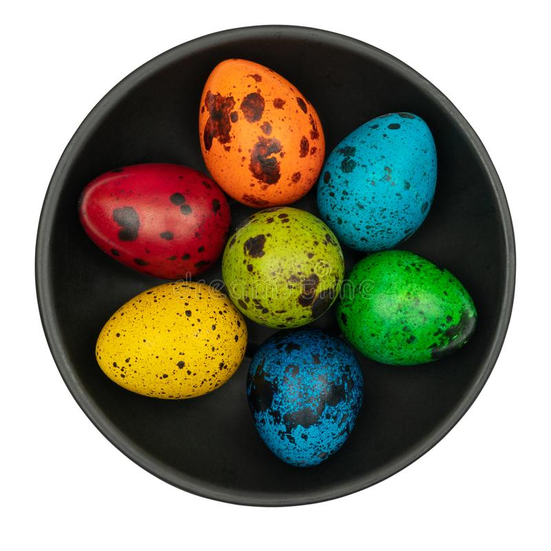 Colorful easter eggs on black plate isolated on white background. royalty free stock photo