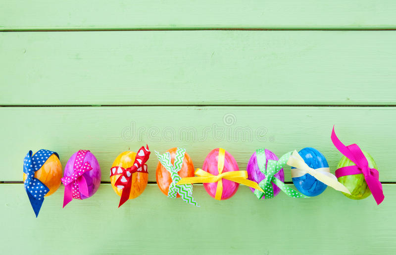 Colorful easter eggs. With cheerful gift ribbons royalty free stock photo