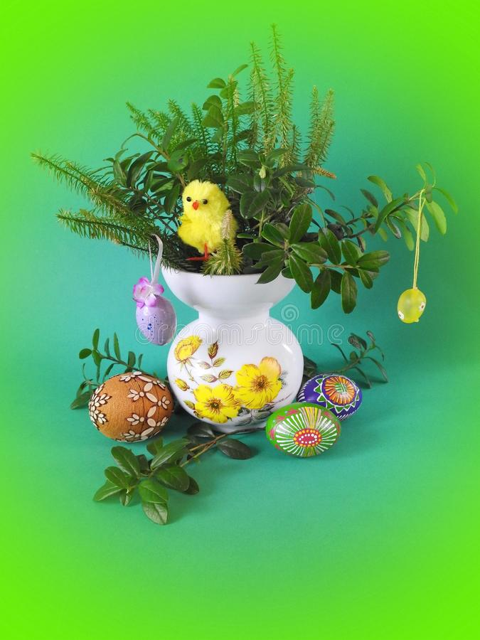 Colorful Easter eggs and chick in vase royalty free stock photography