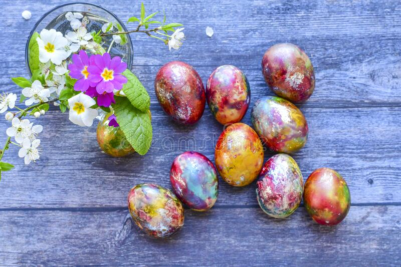 Colorful Easter eggs. Colorful easter hand painted eggs and spring blossom on wooden background royalty free stock photos