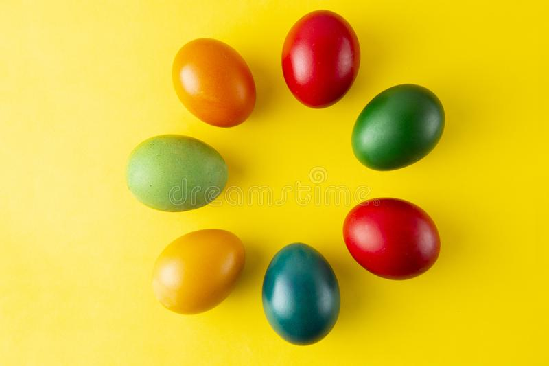 Colorful Easter eggs, easter or spring background with home painted eggs. Top view, copy space. Spring time. Colorful background royalty free stock photo