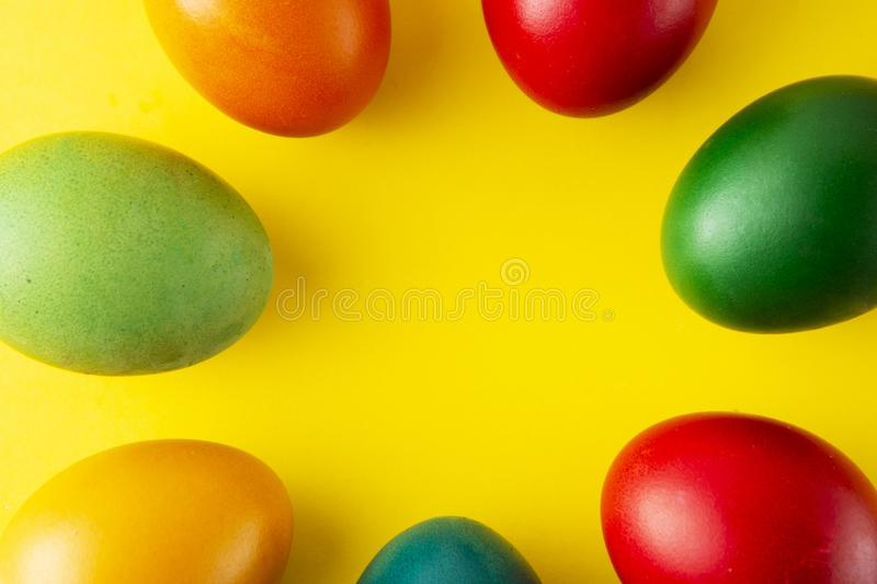 Colorful Easter eggs, easter or spring background with home painted eggs. Top view, copy space. Spring time. Colorful background stock images