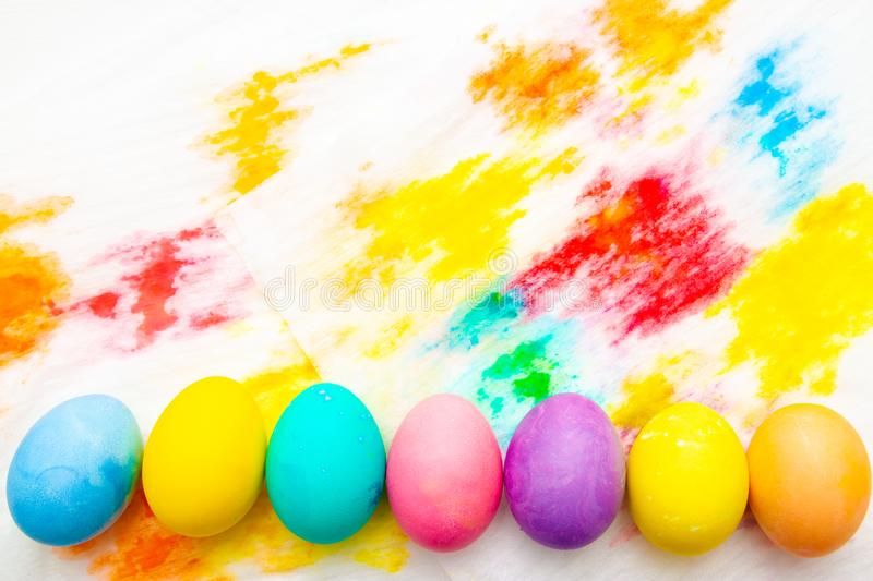 Colorful Easter eggs frame border on multicolor painted background. top view, copyspace royalty free stock photos