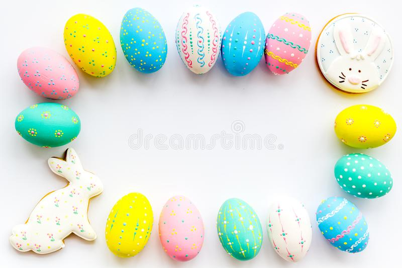 Colorful Easter eggs frame on white background top view copy space stock photography