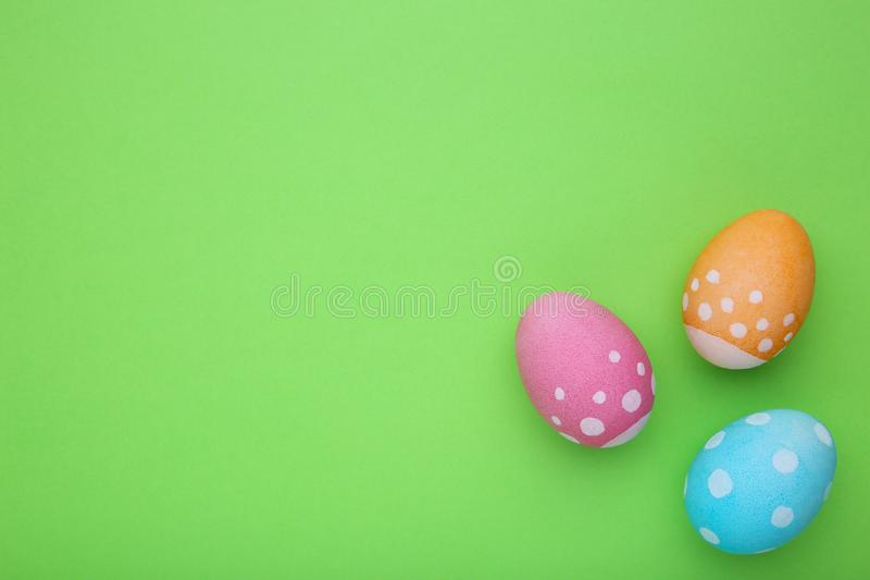 Colorful easter eggs on a green background. Colorful easter eggs on green background royalty free stock image
