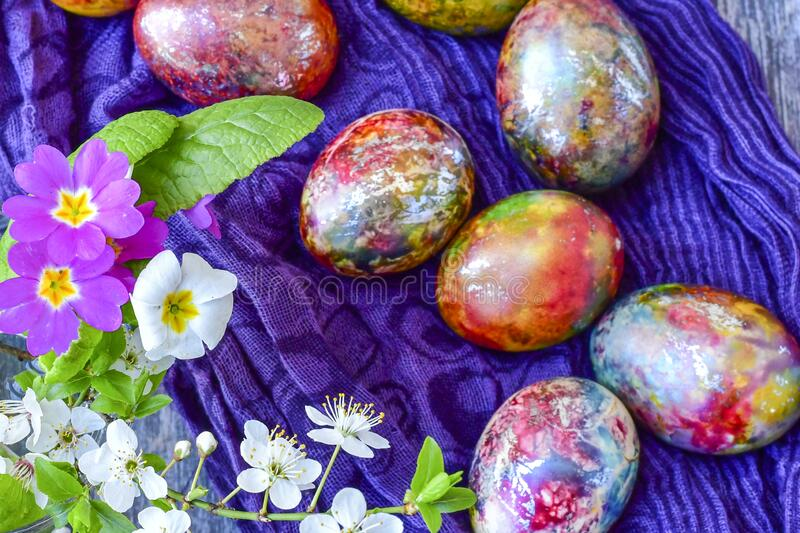Colorful Easter eggs. Colorful easter hand painted eggs and spring blossom on wooden background stock photos