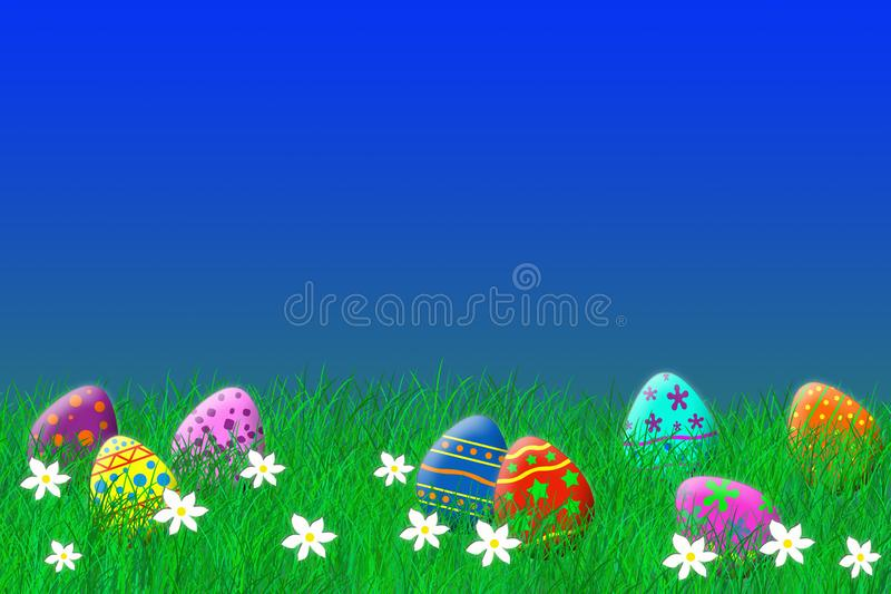 Colorful easter eggs laying in the grass under a blue sky stock photography