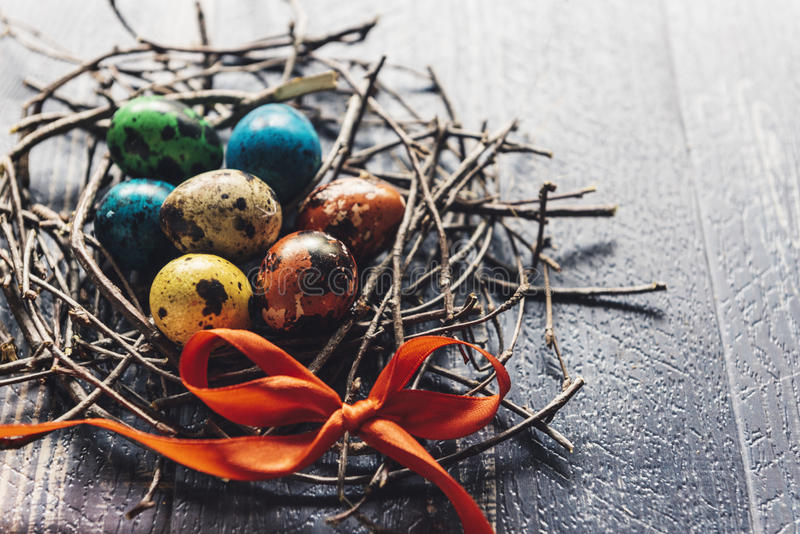 Colorful Easter eggs. In the nest on wooden background,selective focus royalty free stock photography