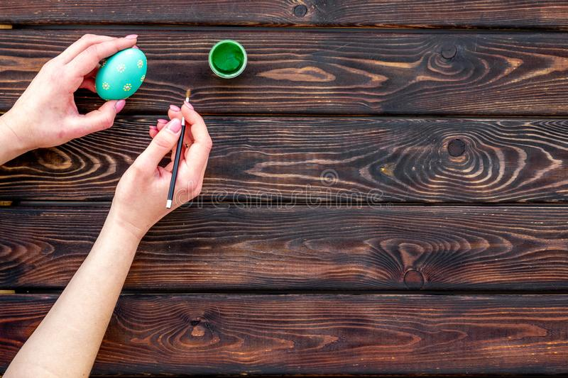 Colorful Easter eggs and paint for celebration on wooden background top view mock up royalty free stock photos